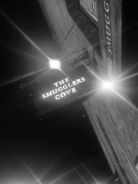 The Smugglers Cove's logo